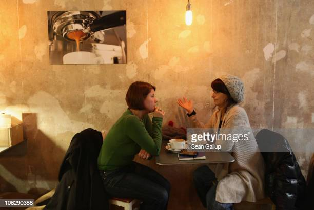 Two young women chat over coffee at Bonanza Coffee Roasters on January 24 2011 in Berlin Germany Bonanza founder Kiduk Reus is among a growing number...
