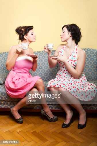 Two Young Women Drinking Coffee