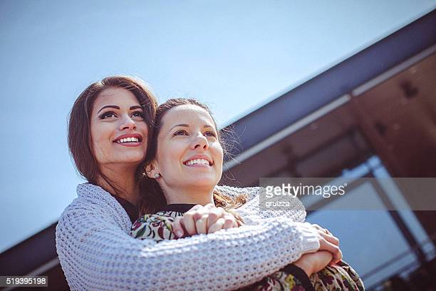 Two young women embracing on a beautiful sunny spring day