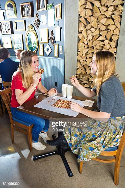 Two Young Women Friends in Restaurant Enjoying Flatbread Pizza