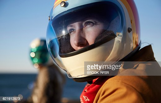 Two young women getting ready for motorcycle ride : Stock Photo