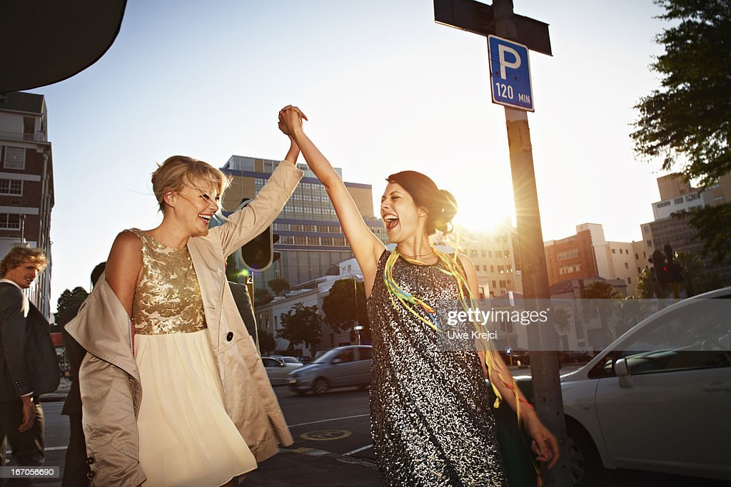 Two young women having fun oudoors : Stock Photo