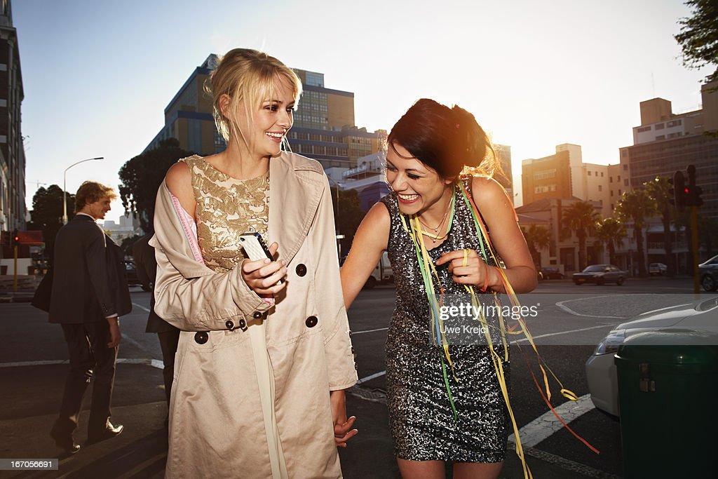 Two young women having fun outdoors : Stock Photo