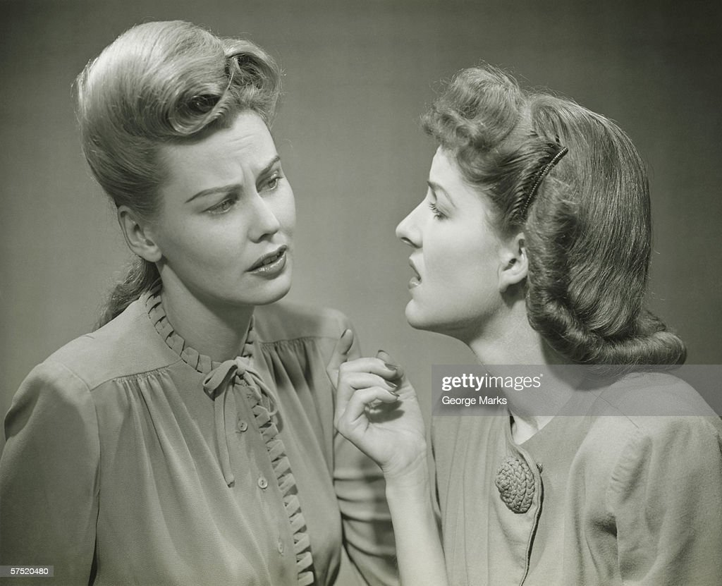 Two young women having serious discussion, (B&W) : Stock Photo