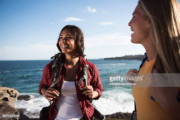Two young women hiking and having fun