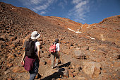 Two young women hiking at Tongariro National Park