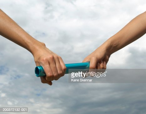 Two young women holding relay baton, close up