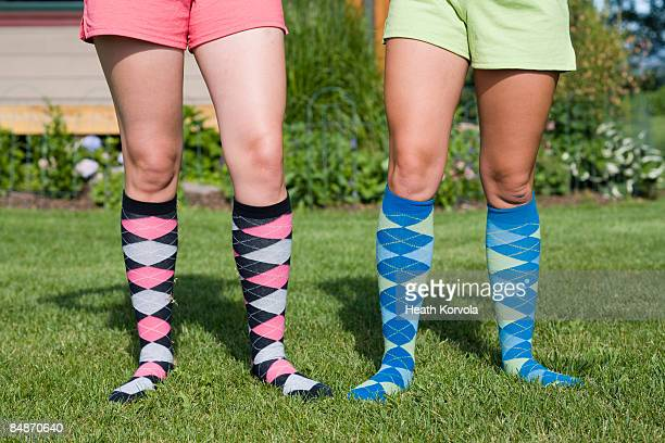 Two young women in argyle socks.