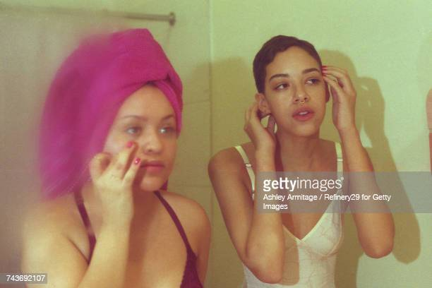 Two Young Women In Bathroom