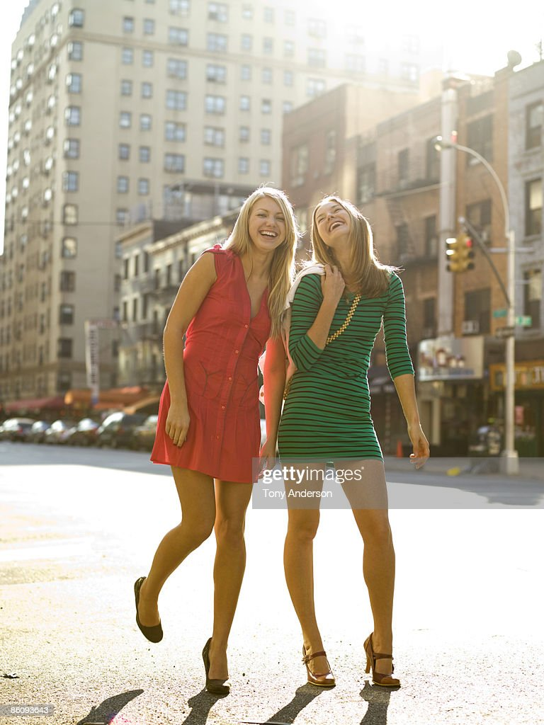 Two young women in urban setting : Stock Photo