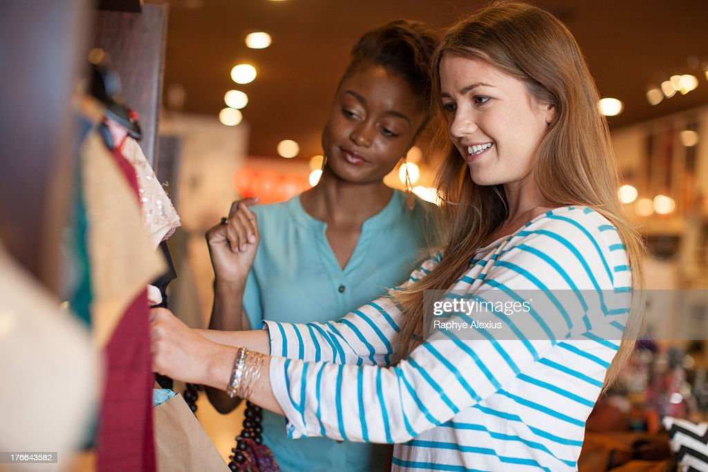 Two young women in vintage shop : Stock Photo