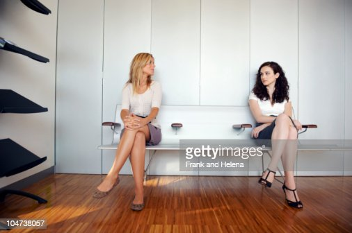Two young women in waiting room : Stock Photo
