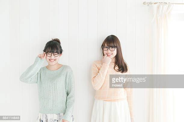 two young women making a pose