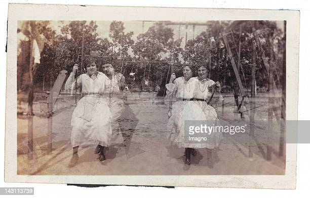 Two young women on the swing Snapshot Double exposure Photograph Around 1920