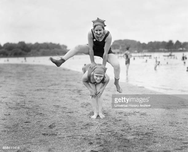 Two Young Women Playing Leap Frog on Beach USA National Photo Company 1921