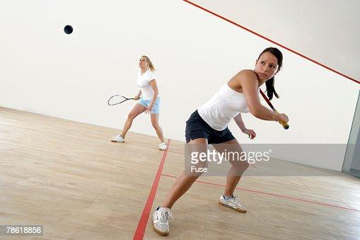 Two Young Women Playing Squash