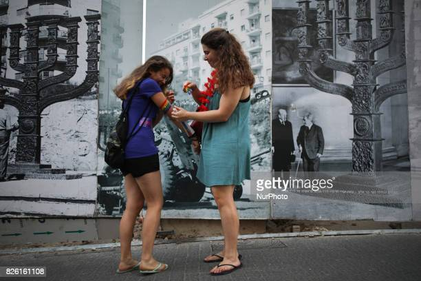 Two young women put stickers on each other during the annual Gay Pride parade in Jerusalem Israel August 03 2017 22000 March in Jerusalem Pride...