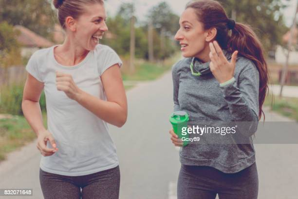 Two young women running