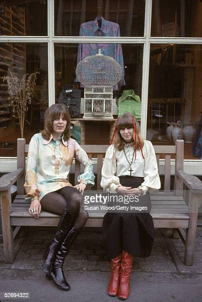 Two young women sit outside a boutique at Kings Road in Chelsea London United Kingdom 1969