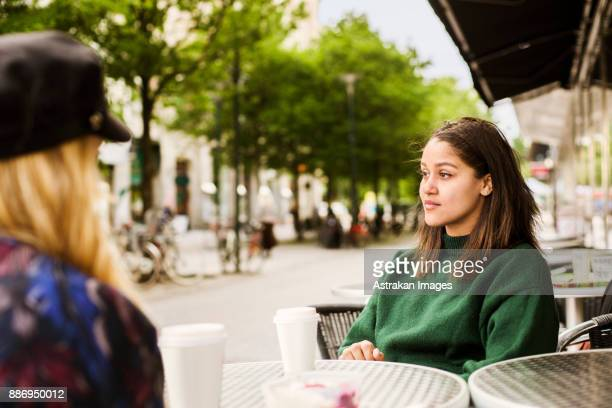 Two young women sitting in cafe