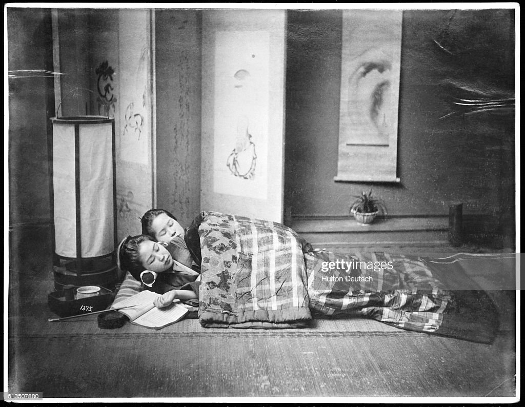 Floor mats to sleep on - Two Young Women Sleep On A Floor Mat Covered With A Checkered Quilt