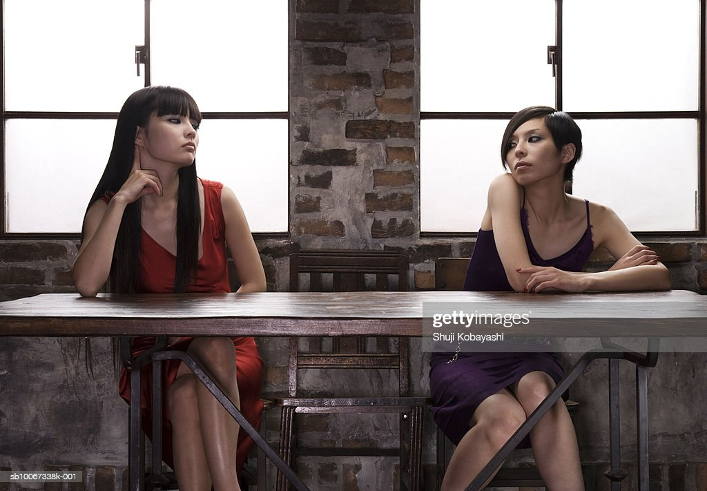 Two young women starring at each other