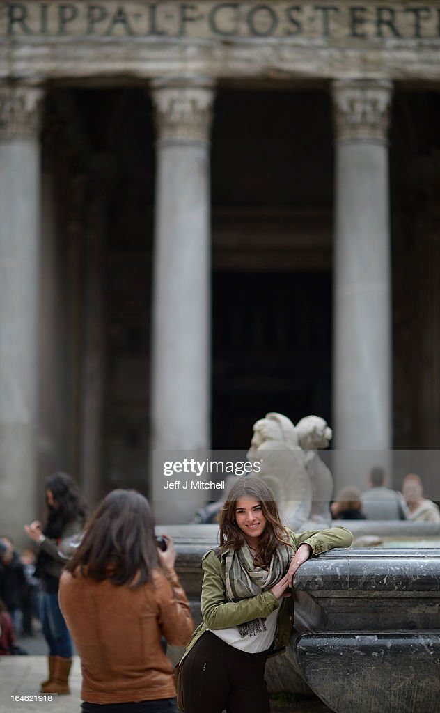 Two young women take a picture in front of the Pantheon on March 25, 2013 in Rome, Italy. Pope Francis yesterday led his first mass of Holy Week as pontiff by celebrating Palm Sunday in front of thousands of faithful and clergy.