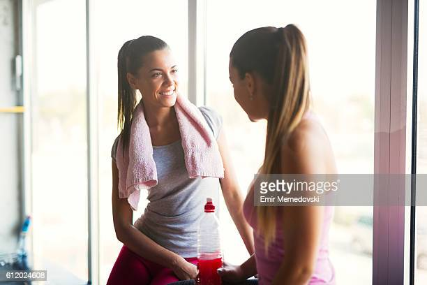 Two young women taking a break from exercising.
