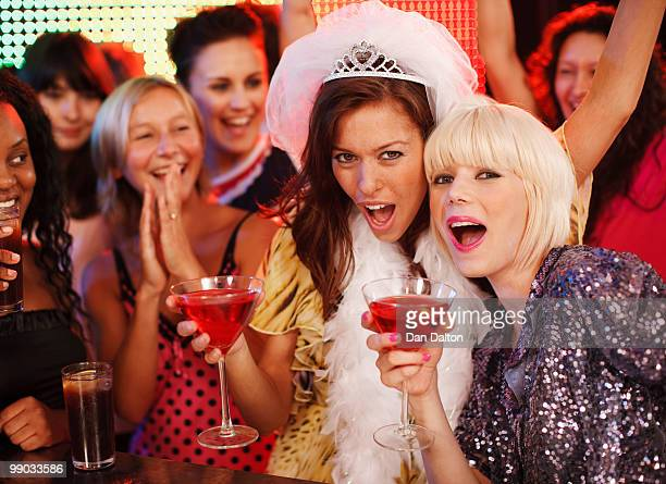 Two young women toasting at a Hen night