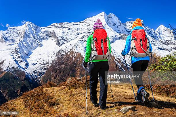 Two young women trekking in Himalayas, Mount Everest National Park