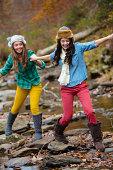 Two young women walk along a riverbed near Lake Chinnabee, Alabama.