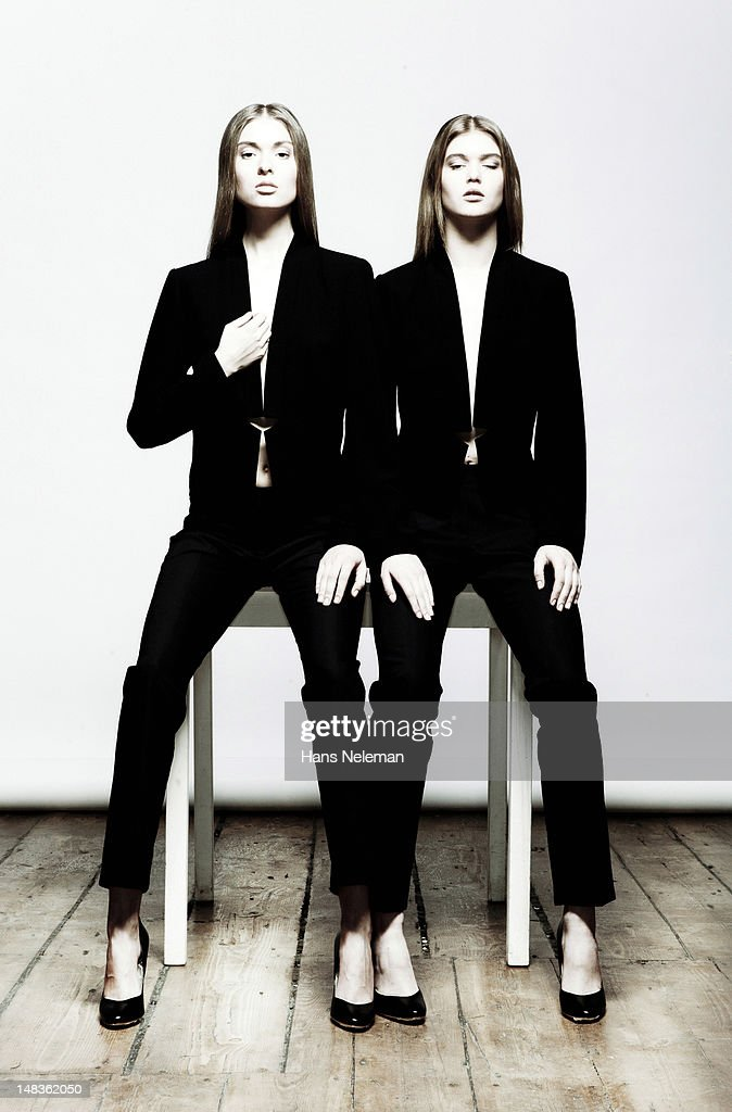 Two young women wearing black fashion wear : Stock Photo