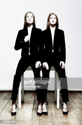 Two young women wearing black fashion wear : Stock Photo