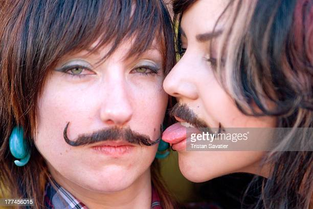 CONTENT] Two young women with false moustaches in gender play