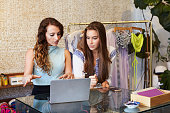 Two young women working in clothing store