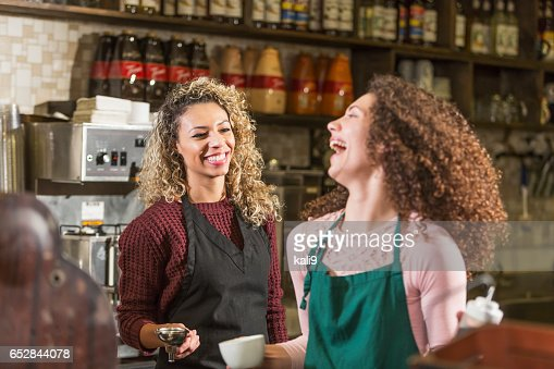Two young women working in coffee shop : Stock Photo