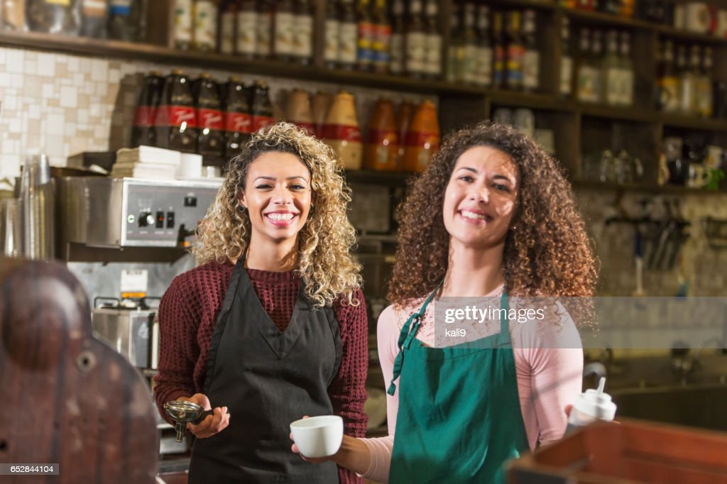 Two young women working in coffee shop : Stockfoto