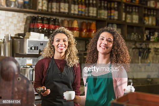 Two young women working in coffee shop : Stock-Foto