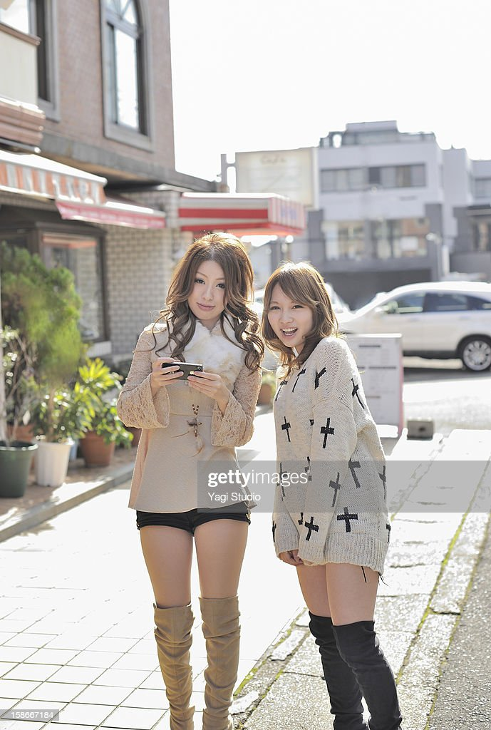 Two young women,smiling : Stock Photo