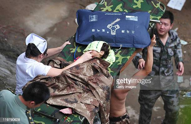A twoandahalf year old girl is carried on a stretcher from the scene of the crash involving two trains on July 24 2011 in Wenzhou Zhejiang Province...