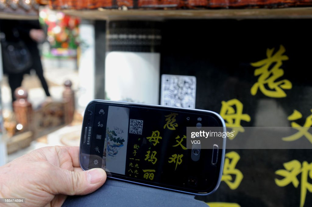A two-dimensional quick response barcode (QR code) is affixed to a tombstone to offer smartphone users extended information about the person buried beneath on April 4, 2013 in Shenyang, Liaoning Province of China. Scanned with digital gadgets, the 2D barcode will provide information and stories about the deceased through photos and videos. Qingming Festival, also known as the 'Tomb Sweeping Day', which falls on April 4 this year, is a traditional time when people pay their respects to the deceased and ancestors, involving cleaning, repairing of tombs and sacrifice activities.