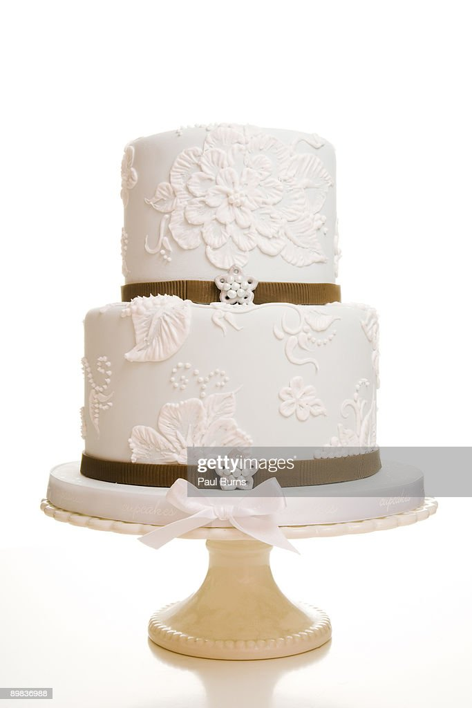 Two-Tiered White Wedding Cake WIth Brown Ribbon : Stock Photo
