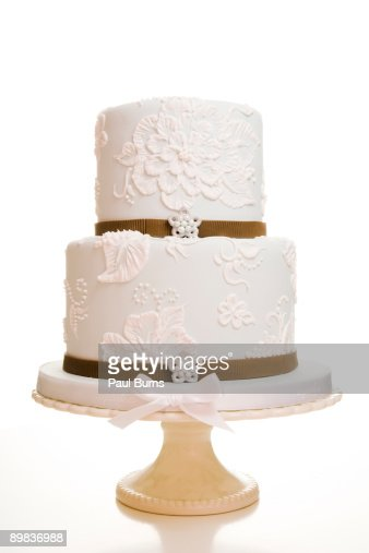 Two-Tiered White Wedding Cake WIth Brown Ribbon