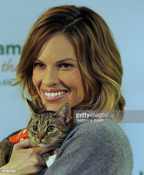 Twotime Academy Award winning actress Hilary Swank poses with a kitten at the Bideawee Animal Center October 19 2009 to raise awareness for the Iams...