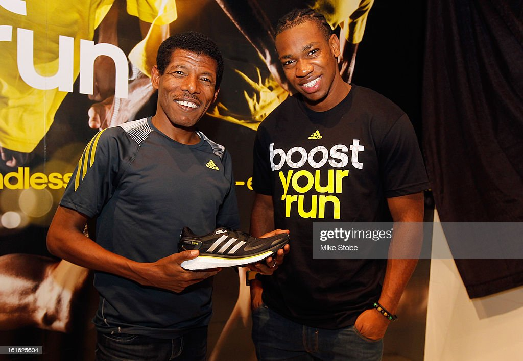 Two-time Olympic Champion <a gi-track='captionPersonalityLinkClicked' href=/galleries/search?phrase=Haile+Gebrselassie&family=editorial&specificpeople=243243 ng-click='$event.stopPropagation()'>Haile Gebrselassie</a> and Olympic Medalist <a gi-track='captionPersonalityLinkClicked' href=/galleries/search?phrase=Yohan+Blake&family=editorial&specificpeople=2172755 ng-click='$event.stopPropagation()'>Yohan Blake</a> pose for a photo at the unveiling of the adidas Energy Boost sneaker at the Javits Convention Center North on February 13, 2013 in New York City.