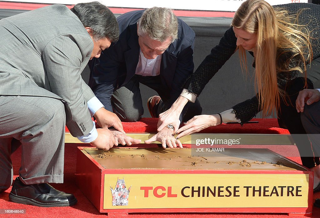 Two-time Oscar winner US actor Robert De Niro, nominated this year for an Academy Award for his role in 'Silver Linings Playbook', places his hand and foot prints in cement during the Footprint Ceremony in front of TCL Chinese Theater in Hollywood, California on February 4, 2013. PHOTO