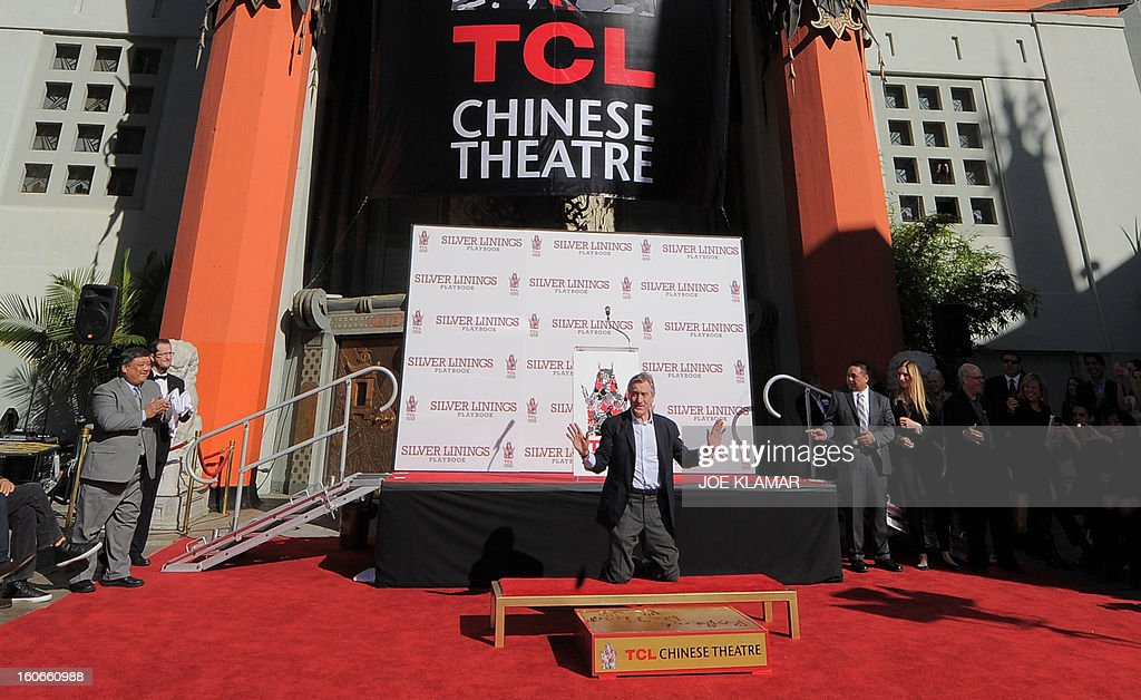 Two-time Oscar winner US actor Robert De Niro, nominated this year for an Academy Award for his role in 'Silver Linings Playbook', places his hand and foot prints in cement during the Footprint Ceremony in front of TCL Chinese Theater in Hollywood, California on February 4, 2012. PHOTO/JOE KLAMAR