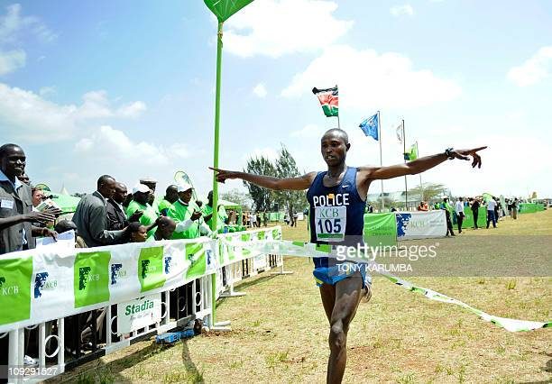 Twotime winner of the Eindhoven Marathon Kenyan Geofrey Mutai celebrates as he crosses the finishline February 19 2011 to win the Senior Men's 12...