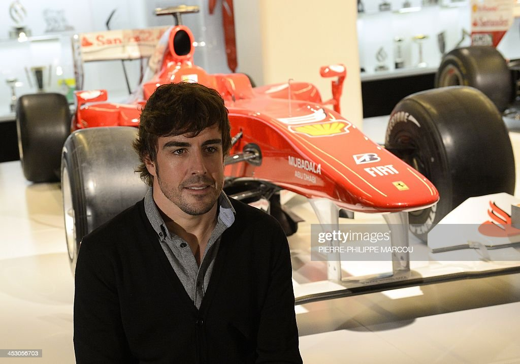 Twotime wolrd champion Spanish Formula One driver Fernando Alonso poses during the inauguration of the exhibition 'Fernando Alonso collection' in...
