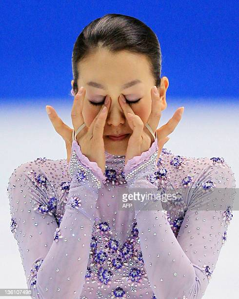 Twotime world champion Mao Asada holds back her tears after winning Japan's national championships in Osaka on December 25 2011 Asada pulled out of...